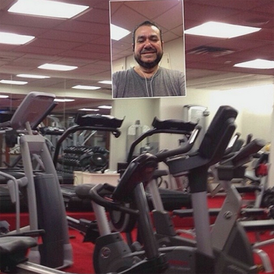 Guy takes selfie in a gym