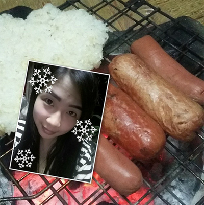 Girl takes selfie with a mouthwatering barbeque