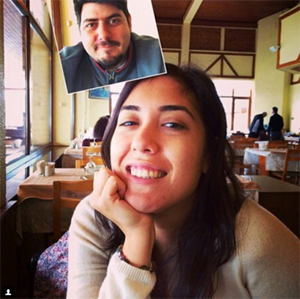 Young girl and boy take selfie at a cafe