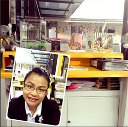Funny young girl takes a selfie at her office