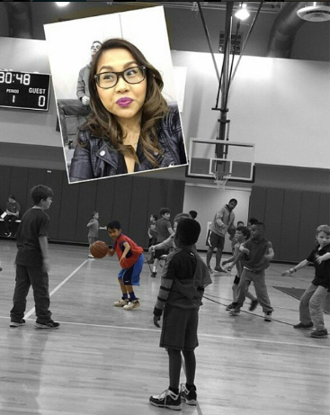 Mother takes selfie with a son who is playing basketball