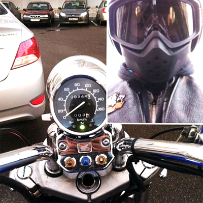 Selfie of a motorcyclist and his bike