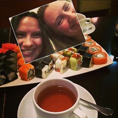 Two girls enjoy their sushi set