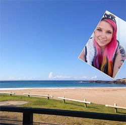 Selfie of a girl with pink hair relaxing on a beach