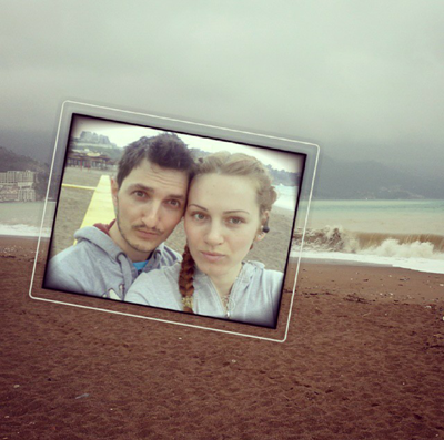 Romantic couple takes a selfie near the sea after the early-morning jogging