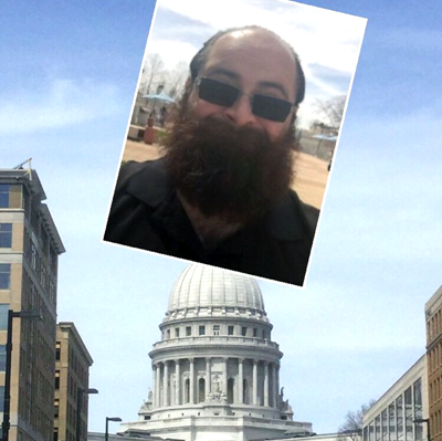 Funny tourist with a big beard takes a selfie