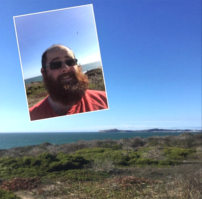 Young and funny bearded man at the coast of Pacific ocean