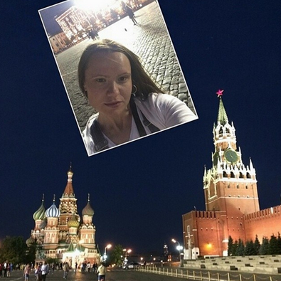 Young Moscow girl takes a selfie on the Red square