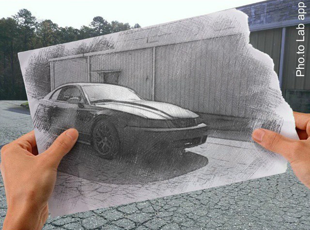 Photo of a Ford Mustang car taken by its owners and turned into a pencil sketch with mobile photo editor Pho.to.Lab