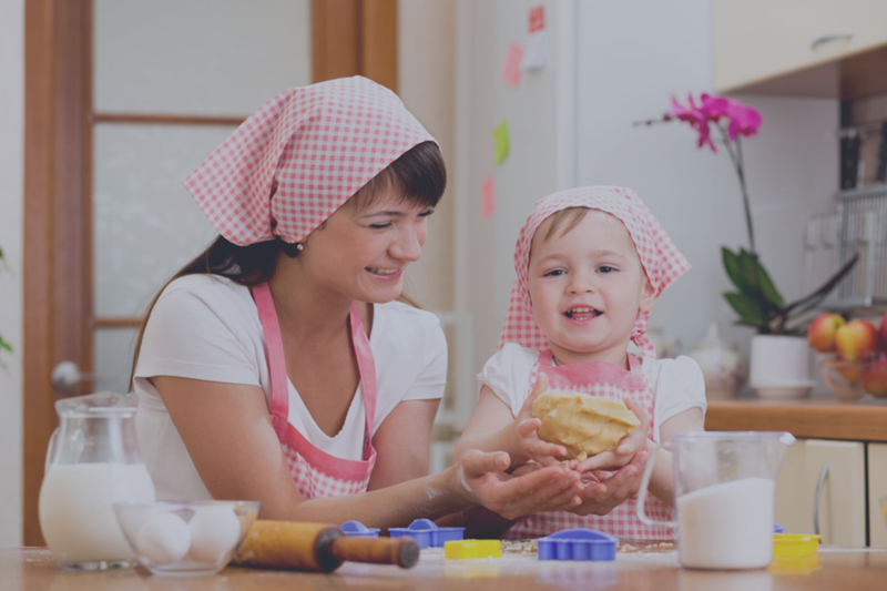 How to enhance an image on the example of a photo with mother and child cooking a cake