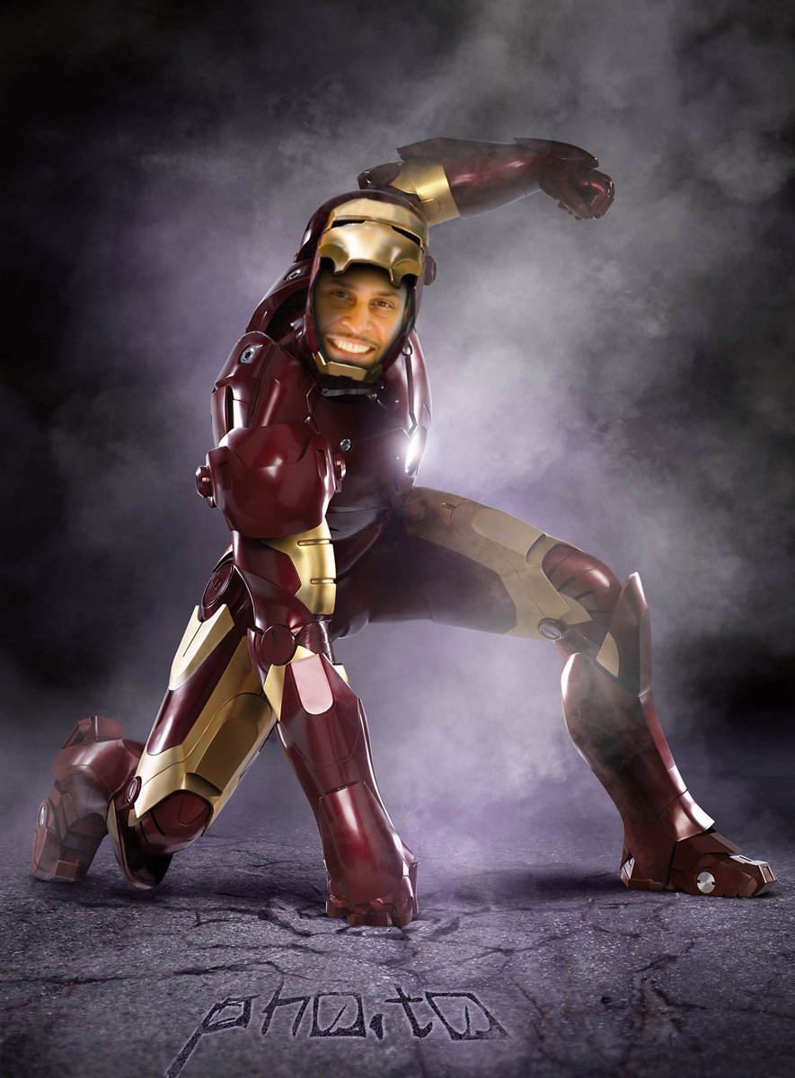 An Iron Man template is used to make a face in hole image with a young guy