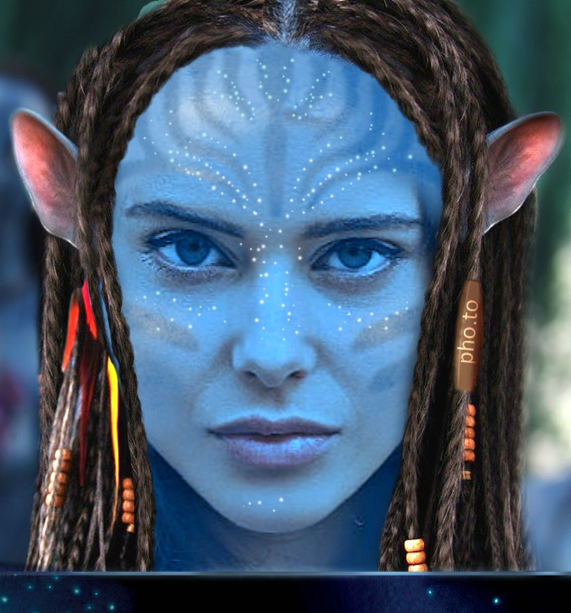 A Navi template from James Cameron's Avatar is used to make a face in hole image with a young beautiful girl