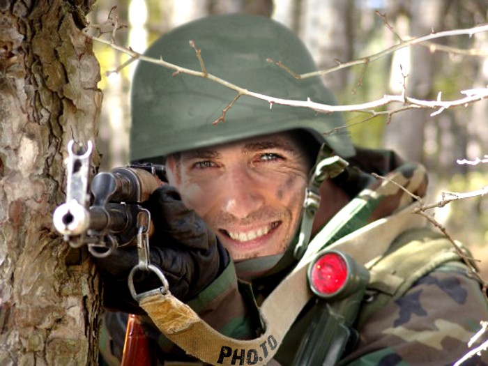 The soldier photo template is used to make a face in hole image with a young guy wearing soldier uniform and holding a big assault rifle