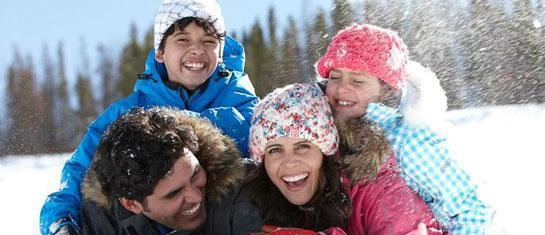Family having fun in winter
