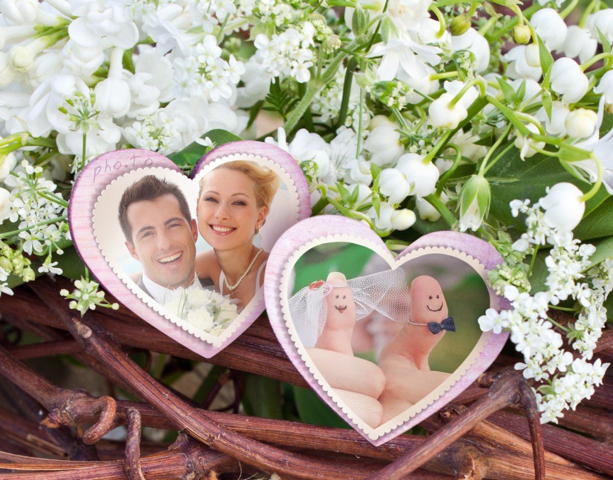 A double photo frame with flowers and paper hearts