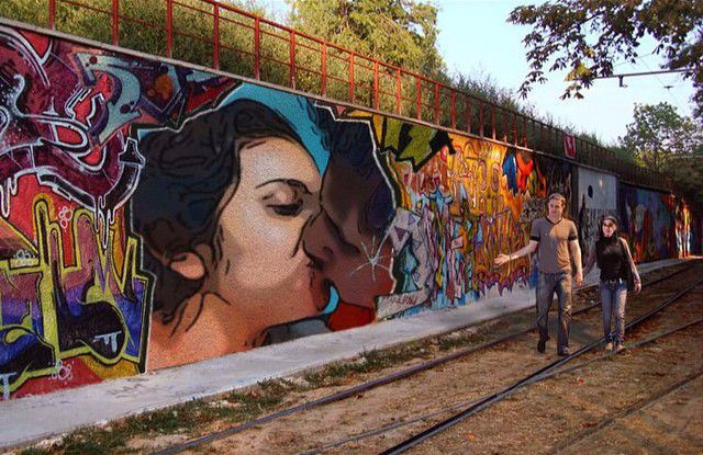 Photo of a loving couple placed on a wall with graffiti photo effect