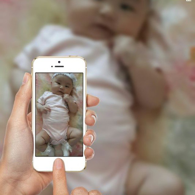 Photo montage with a baby photo and iPhone