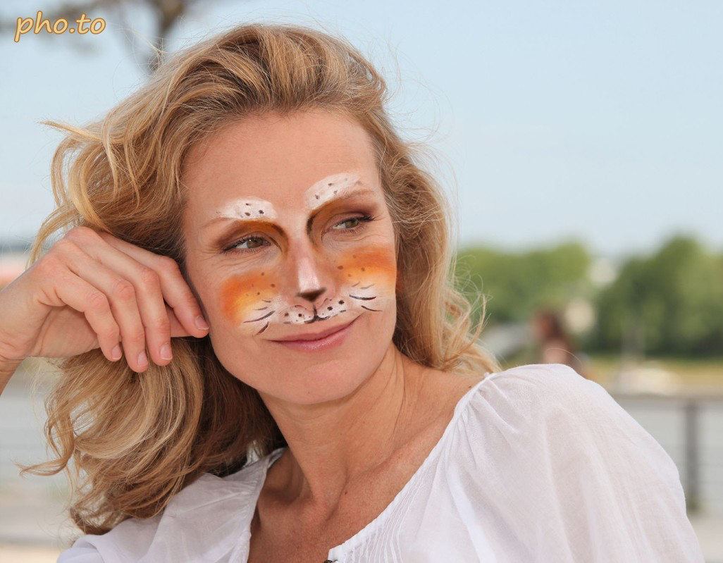 The cat make up photo effect was added to a photo of a beautiful blonde woman