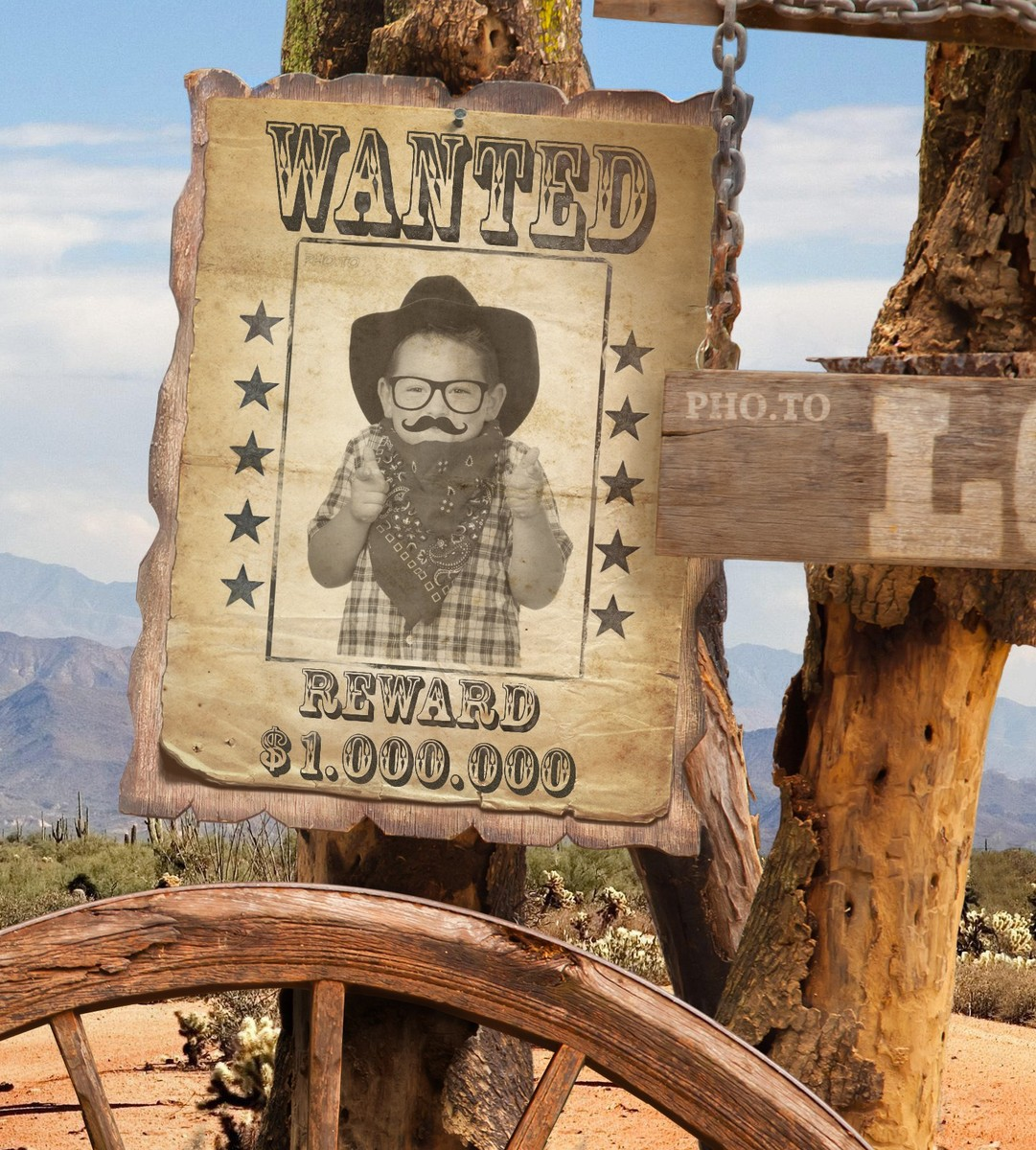 A photo of a small boy was placed into the Wanted poster photo frame