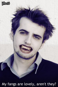 A scary man with vampire fangs added online