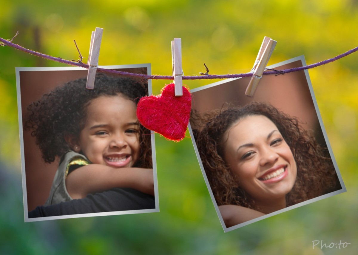 Photos of smiling mother and daughter pinned to a drying rope