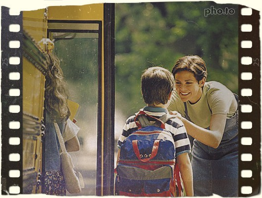 Mother taking her son to school