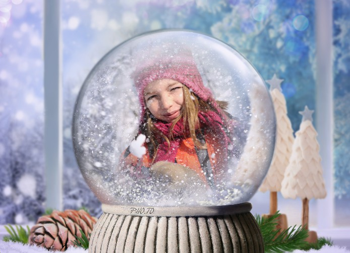 This holiday photo frame places a photo into a beautiful snow globe