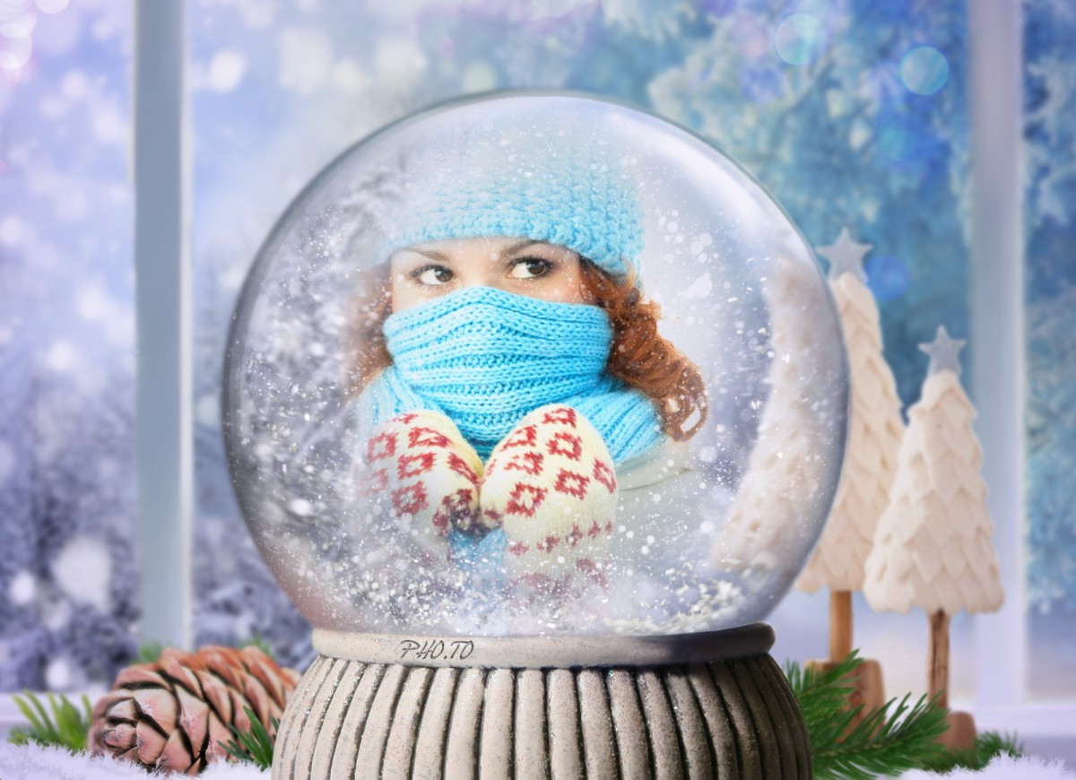 Beautiful winter photo frame with a snow globe