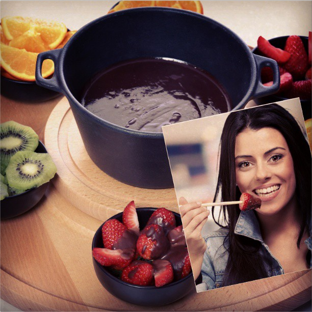 A young girl enjoys her fondue and takes selfie