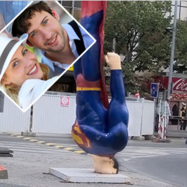 A happy couple near the Fallen Superman monument