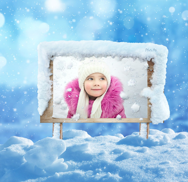 Winter photo frame with snow on a wooden board