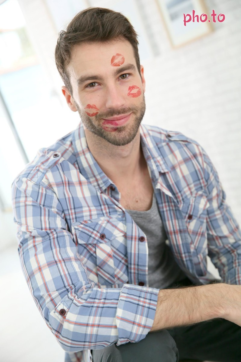 A photo effect adorned guys photo with red kisses
