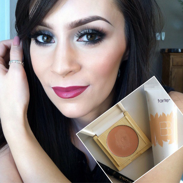 A  selfie shot of a girl wearing professional make up with cosmetics used to apply it