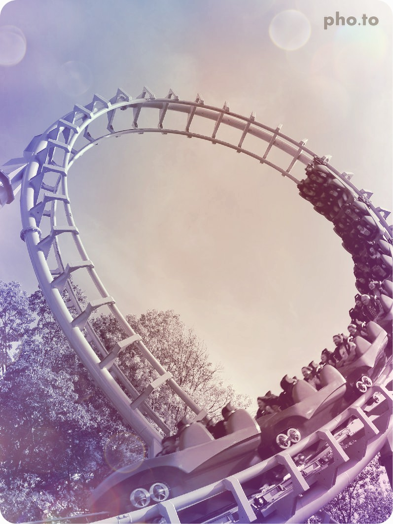 A photo of roller coaster edited with a color filter to accentuate its atmospheric mood