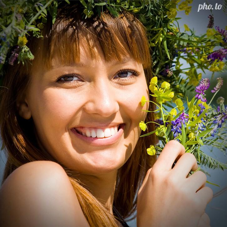 A portrait photo of a girl edited to add a light dark vignette