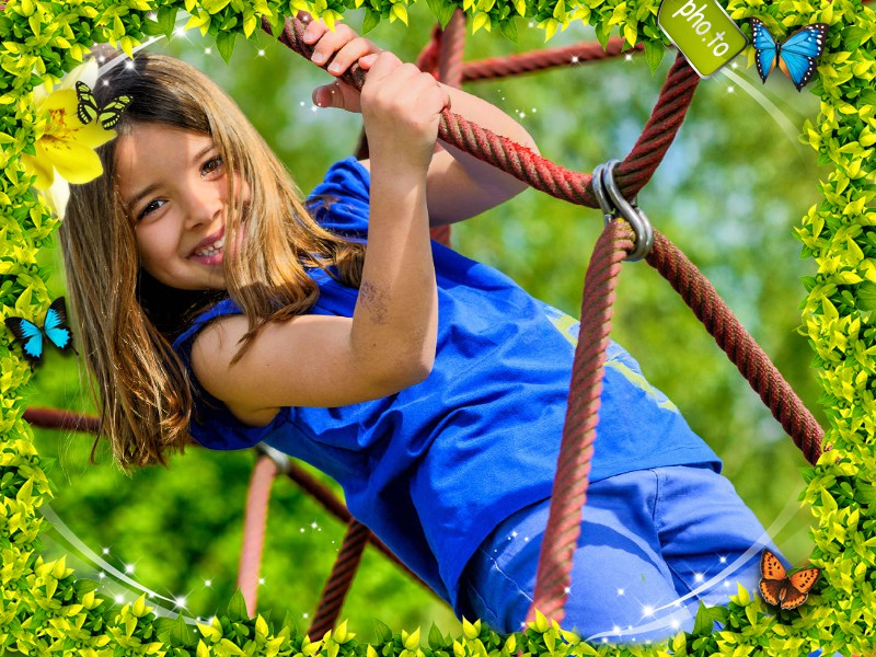Green photo frame with butterflies is applied to a photo of girls, playing in the rope park