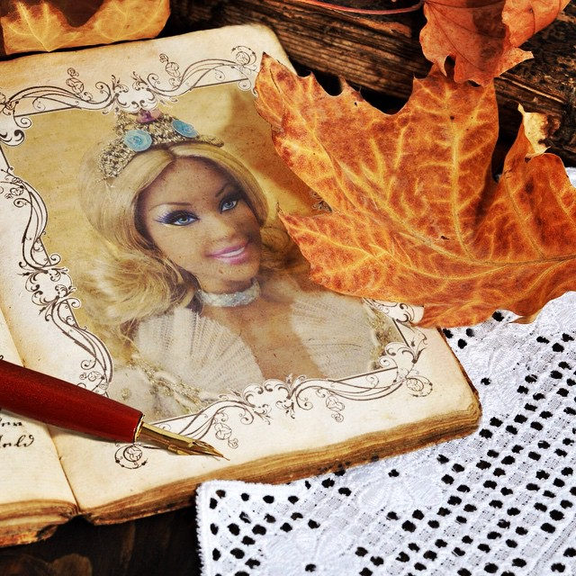 Autumn photo frame with a photo of a Barby doll