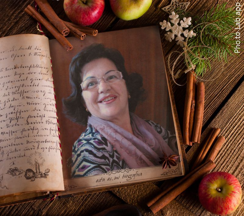 Unusual Christmas frame with cinnamon, apples and fir tree twig is added to a photo of an aged attractive woman