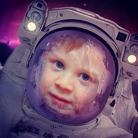 Photo of a kid wearing a space suit made with astronaut photo template