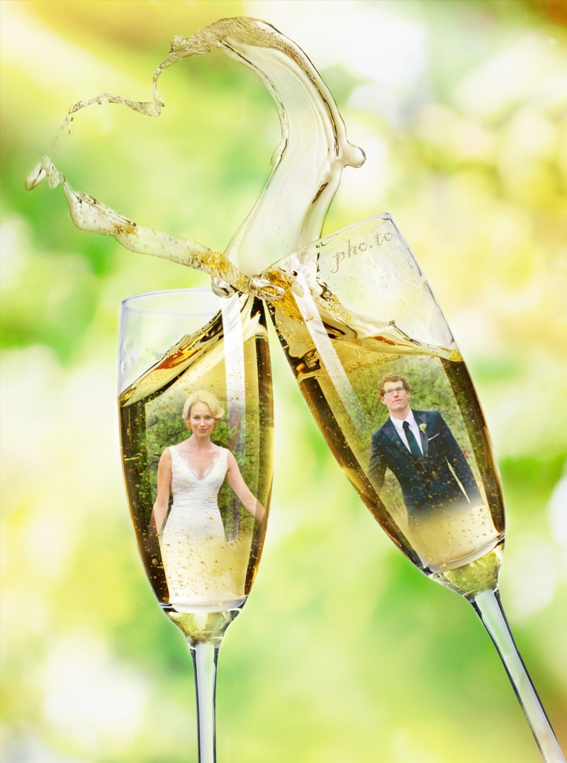 Bride and groom reflected in champagne glasses