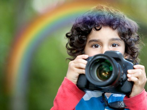 A rainbow was added to a portrait photo of little photographer