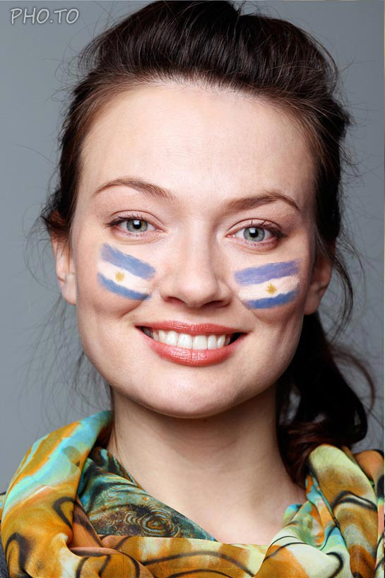 A patriotic face painting with Argentina flag